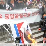 北朝鮮、正恩氏写真を燃やされ激怒 五輪「慎重に考慮」